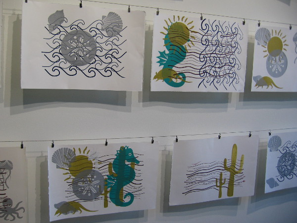 The serigraphs on this wall were made by students in the SDSU Graphic Design program. Imagery depicts ocean and desert ecosystems as migratory environments.