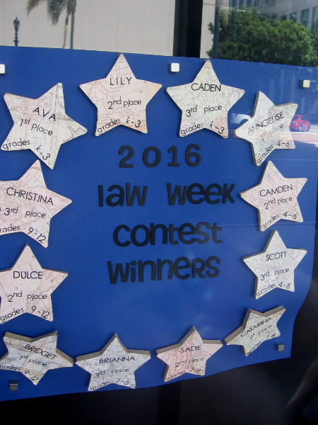 2016 Law Week Poster Contest winners in window of San Diego's downtown Edward J. Schwartz United States Courthouse. Students from a variety of local schools participated.