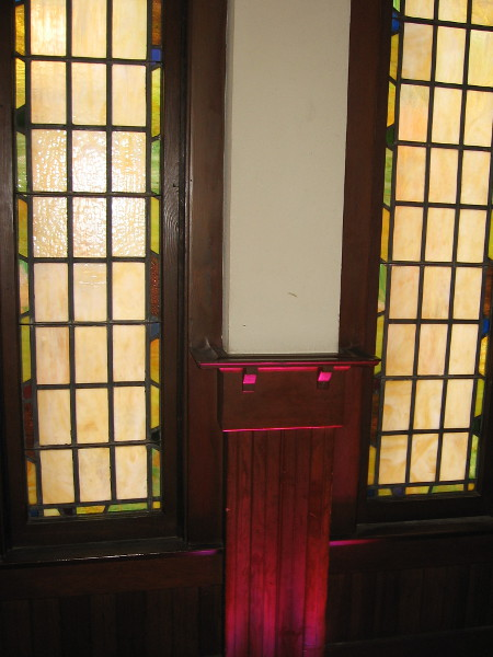 More stained glass behind dining tables on the north side of the second floor.