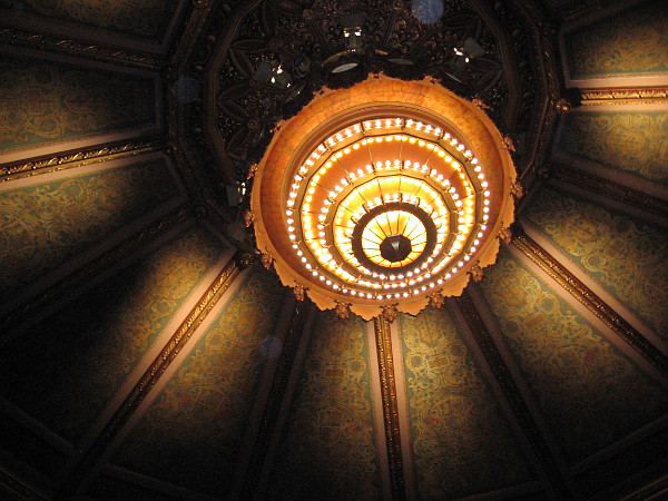 The huge, resplendent central chandelier and those around it can be lowered on cables. This is helpful when about a thousand light bulbs need replacement! In the olden days, dancing girls performed for the audience from atop this chandelier!