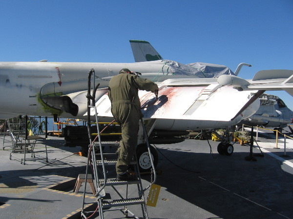 This USS Midway volunteer is grinding away rust from the museum's A-6 Intruder bomber. He said it's the type of work that is done between larger projects.