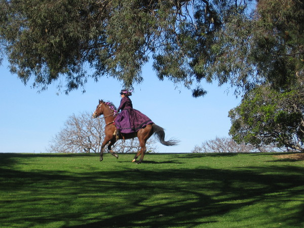 A rider heads across the grass of Balboa Park's lush green Marston Point.