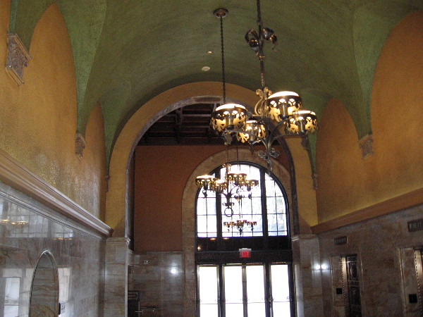 The beautiful arched ceiling near the bank of elevators.