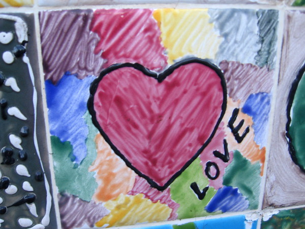 A red heart on patchwork colors. Love.