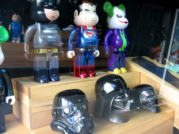 Window near entrance to a Gaslamp retailer contains DC Comics characters and Star Wars helmets. Comic-Con is a few months away!