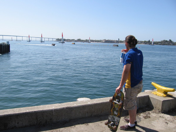 Skateboarder at end of G Street Pier looks out at Red Bull Air Race course an hour before the cool event begins on Saturday in San Diego.