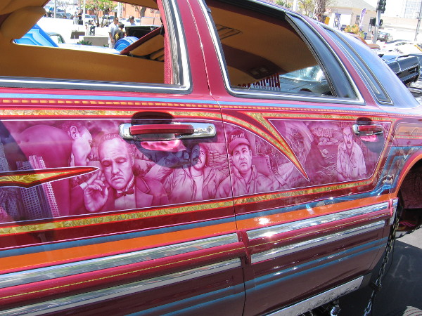 Cool graphics on the side of a customized lowrider on display at this year's Chicano Park Day Celebration. Many of the cars were fitted with hydraulic systems.