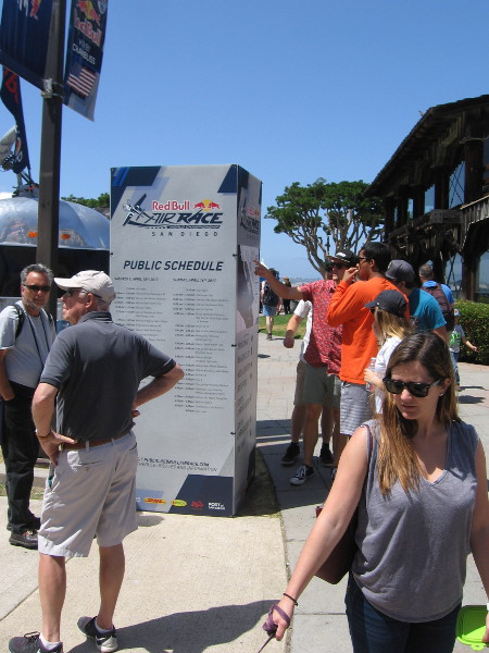 Near one paid entrance, at Embarcadero Marina Park North, a sign showed the event schedule and provided info about the Red Bull planes and pilots.