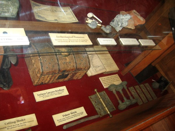 A display case in San Diego's first courthouse contains artifacts from the 19th century, including old pipe bowls and an antique lawyer's briefcase.