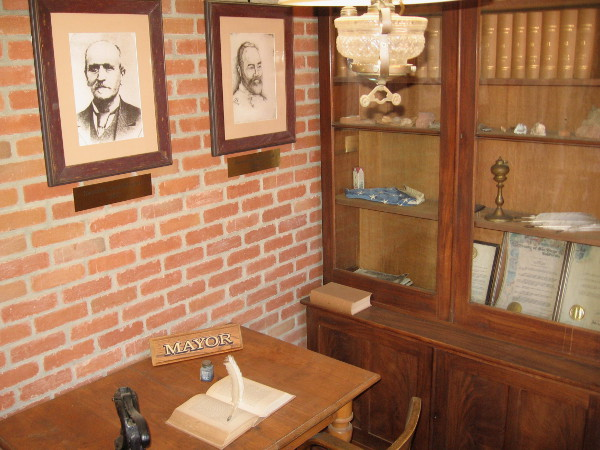 This room in the small building was the mayor's office. Portraits of some early San Diego mayors are on the wall. Joshua H. Bean was San Diego's first mayor, elected in 1850.
