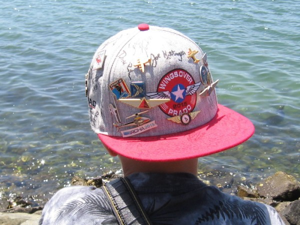 Young aircraft enthusiast has pins from many aviation events and air shows.