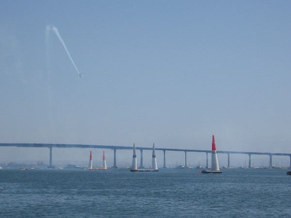 The Red Bull Air Race has resumed! A pilot descends toward the starting pylons!