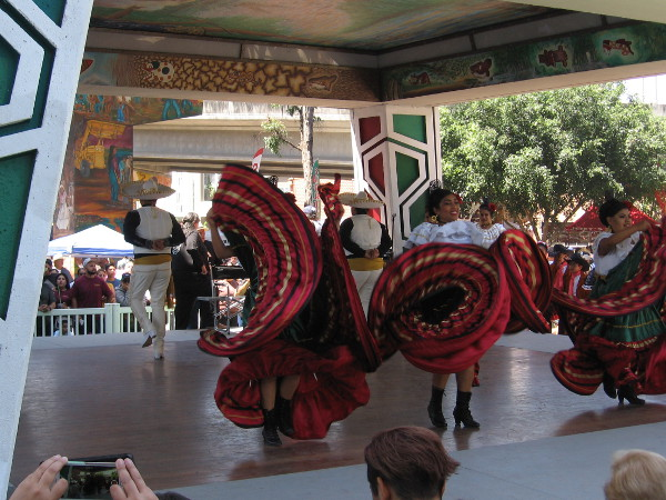The folklorico dancing produces smiles, cheers and applause. The park's pavilion, also called the Kiosko, was designed to look like a pre-Colombian Mesoamerican temple