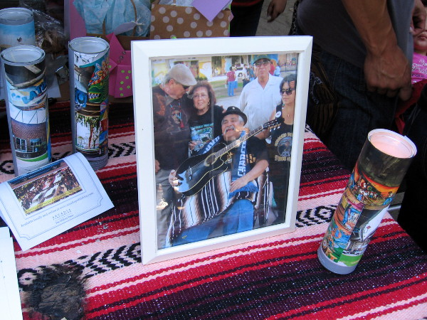 Photograph at one table shows the late Chicano musician Ramón Chunky Sánchez.
