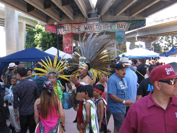 Many dancers who would perform at the Chicano Park Day Celebration wore resplendent Aztec costumes.