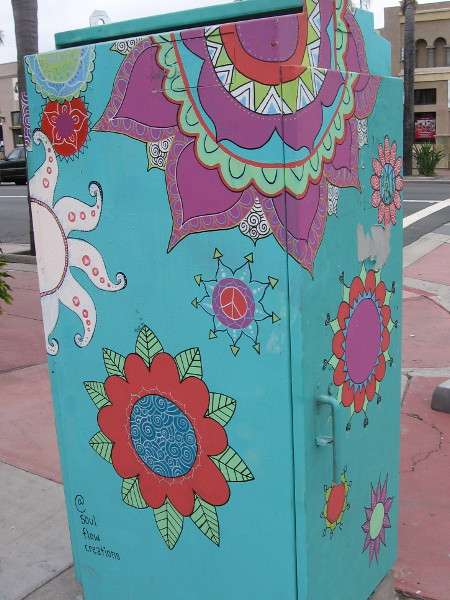 Colorful designs like snowflakes on an electrical box seem like visions in a beautiful dream.