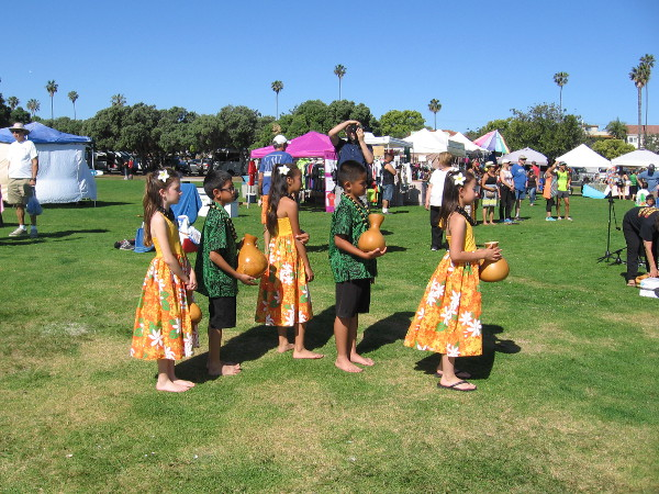 Youth prepare to take the stage. They hold ipu gourds, a traditional musical percussion instrument in Hawaii.