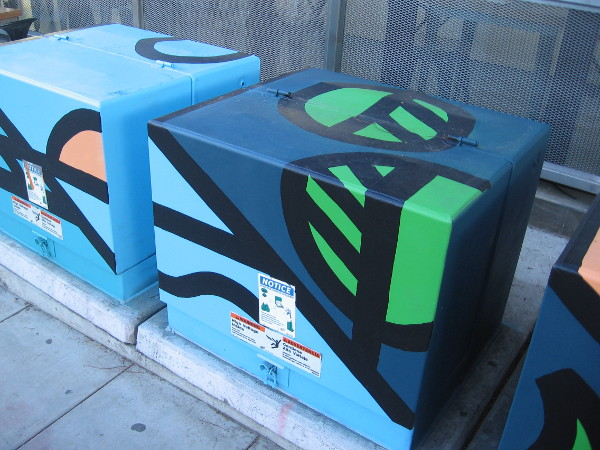 Boldly painted colors on a row of electrical boxes in Little Italy.