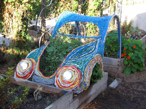 This super cool car made of colorful wires recently appeared at The Garden Project of the New Children's Museum.