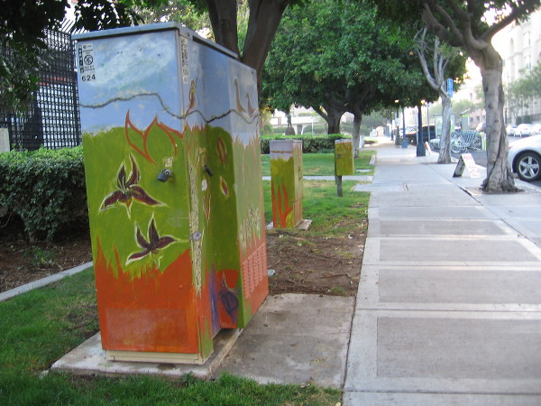 Fun utility boxes near Pantoja Park feature lots of artistic flowers and birds.
