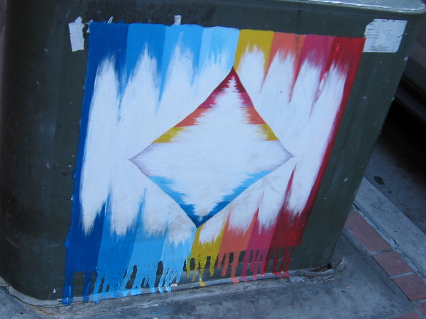 More random colorful street art on a downtown sidewalk.