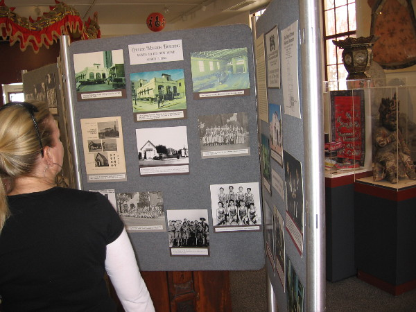 Someone looks at old photos of San Diego and Chinese residents who helped to build and grow our city.