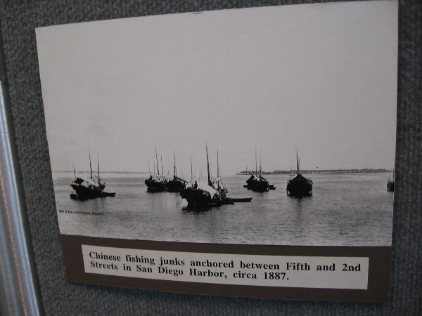 Historical photograph of Chinese fishing junks anchored in San Diego Harbor around 1887.