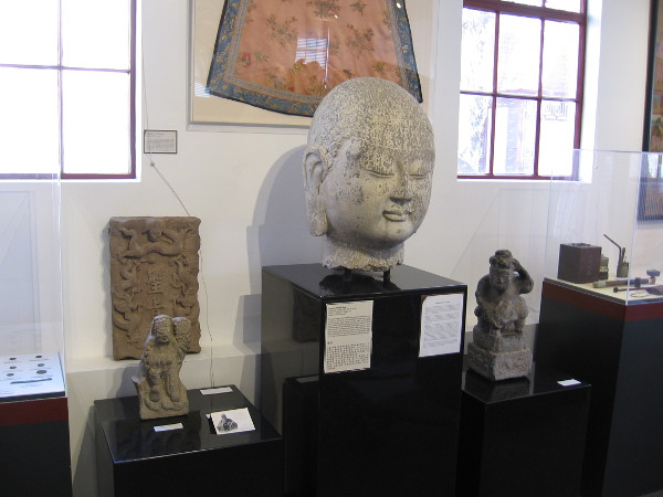 The limestone Buddha head of the Northern Qi Dynasty, was originally carved into a cave in Shanxi Province.
