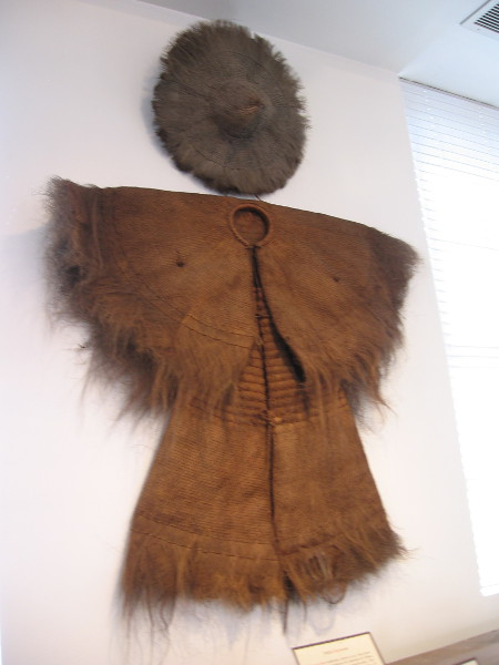 A palm raincoat, called so yee, worn by fishermen and farmers for centuries in China.