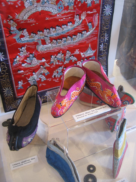 Colorful woven art, and Chinese shoes and slippers for bound feet.
