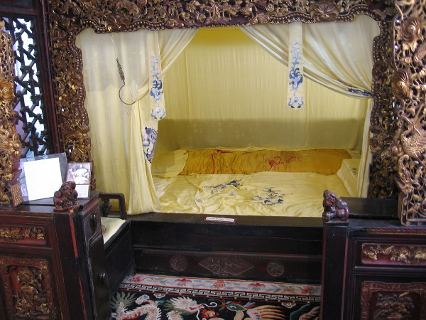 The gilt red-lacquered alcove bed, or babu chuang, was made of southern elm in the Sichuan province in the late 19th century.