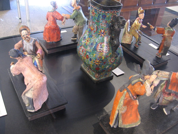 Clay Chinese opera figurines represent different scenes. The characters are from local theatrical traditions, and utilize a complicated set of symbolic gestures.