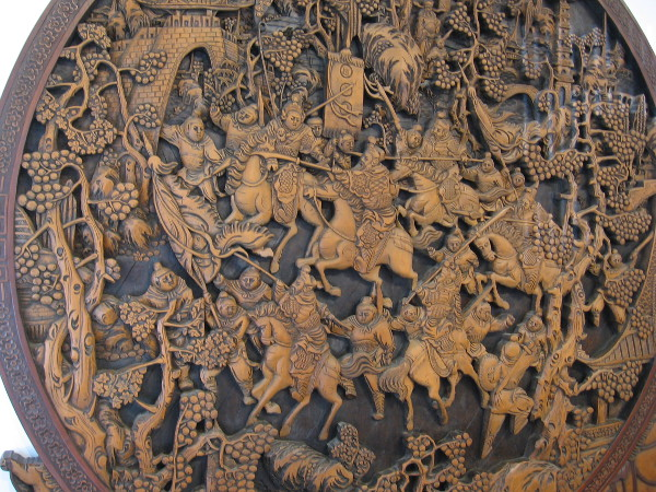 A scene from the Romance of the Three Kingdoms. The elaborate wood carving depicts the battle that Zhao Yun fought to save the sun of Liu Bei.