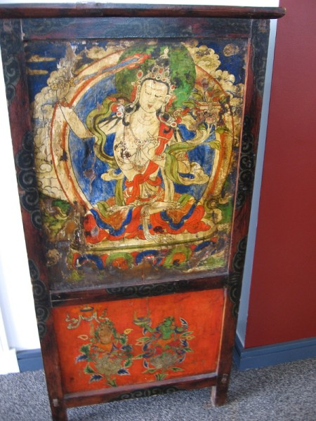 Manjusri altar table, from the late 19th century. Manjusri is the Bodhisattva of wisdom--he holds a sward that cuts through ignorance and illusion.