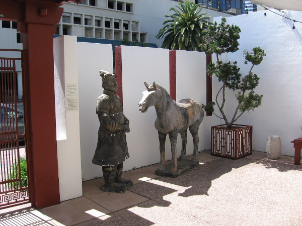 Terracotta horse and general are replicas from the Terracotta Army unearthed at Xian, China. They occupy a corner of the museum's outdoor Chuang Garden.