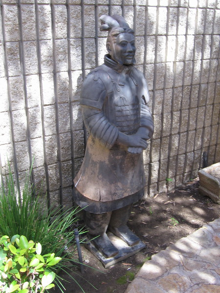 Another warrior statue in the cool shade.