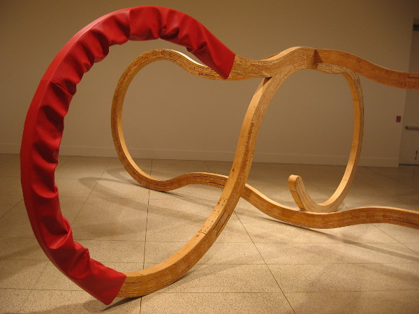 Double Talk by artist Richard Deacon, winner of the Turner Prize. Laminated wood and imitation leather. 1987.