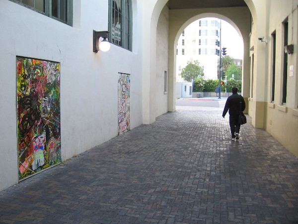 Someone was walking the opposite direction through the breezeway, toward Kettner Boulevard.