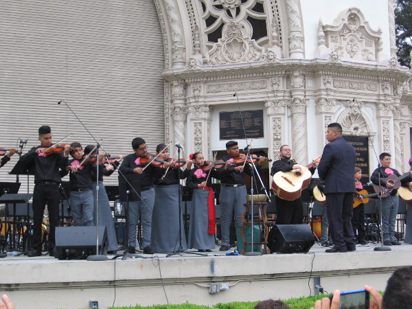 The City Heights Music School Mariachi Ensemble plays for the large crowd.