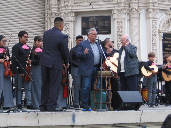Oscar Amezcua comes onto the stage at the Spreckels Organ Pavillion, introduced by his popular journalist son Carlos.