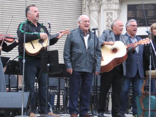 The ageless Oscar Amezcua sings. The mariachi music full of vigor and joy.