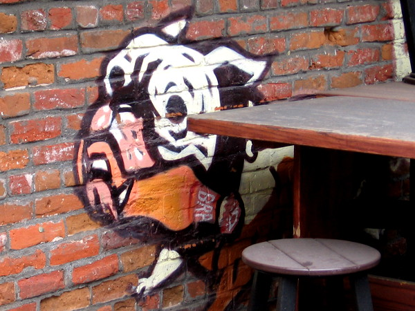 This dog painted on the wall of the now closed Dick's Last Resort seems to be fetching a beer.