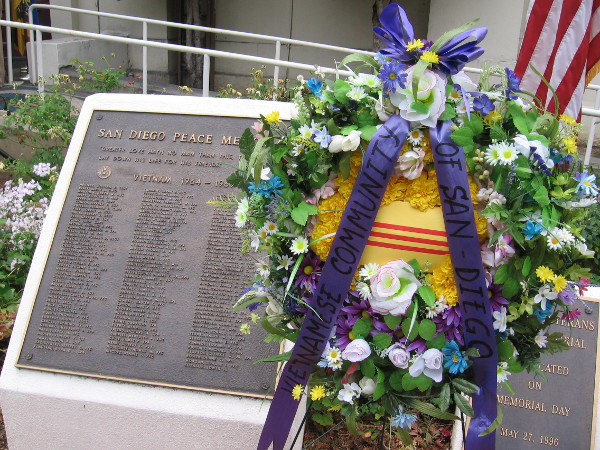 Vietnamese Community of San Diego wreath stands in front of the San Diego Peace Memorial.