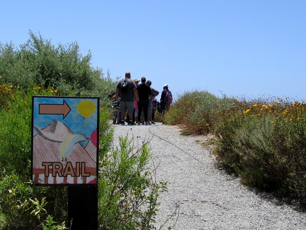 A group begins a nature hike down a trail at San Diego Bay National Wildlife Refuge.