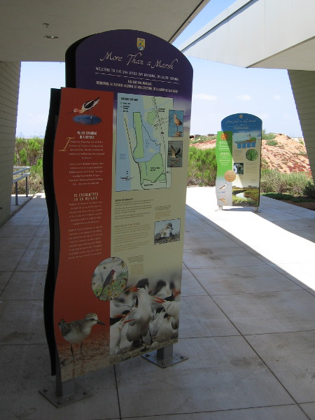 Large signs explain the role of a wildlife refuge.