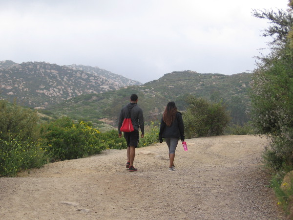 Hikers climb the Lake Poway Trail on an overcast weekend morning.