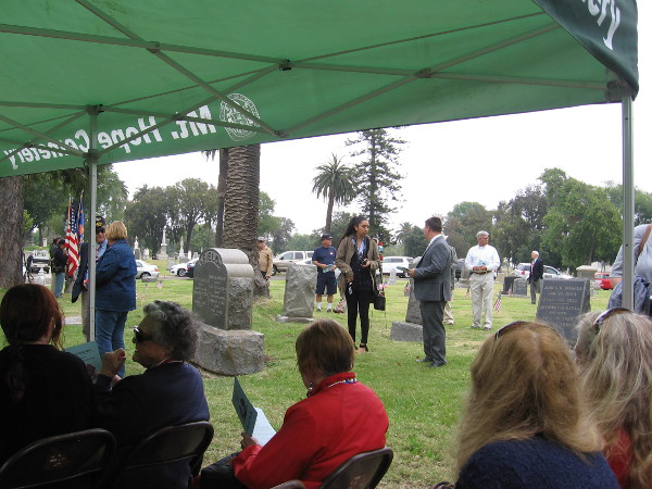 While some gathered for the ceremony, others read the nearby gravestones and wondered at the sacrifices made long ago.