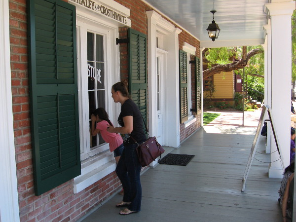 Visitors to Old Town San Diego peer into the Whaley House window just left of the front door. That is where the Whaley and Crosthwaite General Store was located.