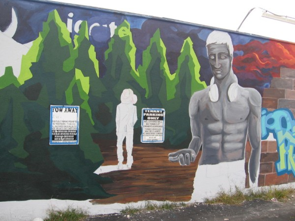 A few days later, a human figure in the mural is coming to life. I look forward to seeing the finished work!