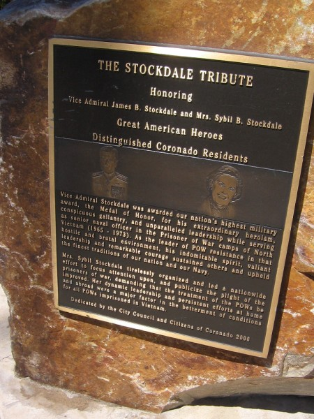 A plaque on a boulder by the flagpole. The Stockdale Tribute. Vice Admiral Stockdale and his wife Sybil were distinguished Coronado residents.